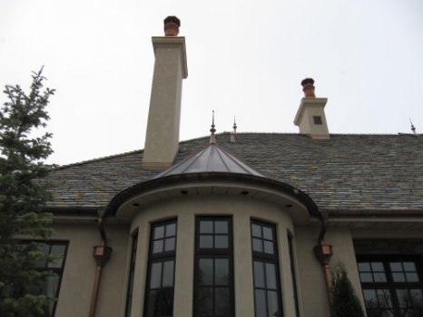 16-turret-roof-gutter-and-ornate-leaderheads