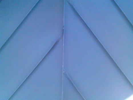 44-zinc-standing-seam-roof-hip-detail