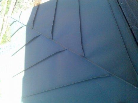 45-zinc-standing-seam-roof-hip-detail